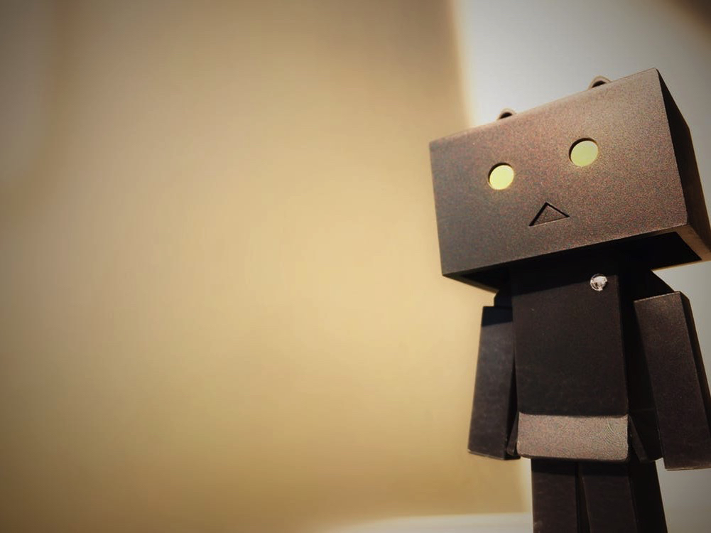 robot with a square head and yellow eyes