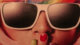 closeup lady wearing sun rainbow glasses