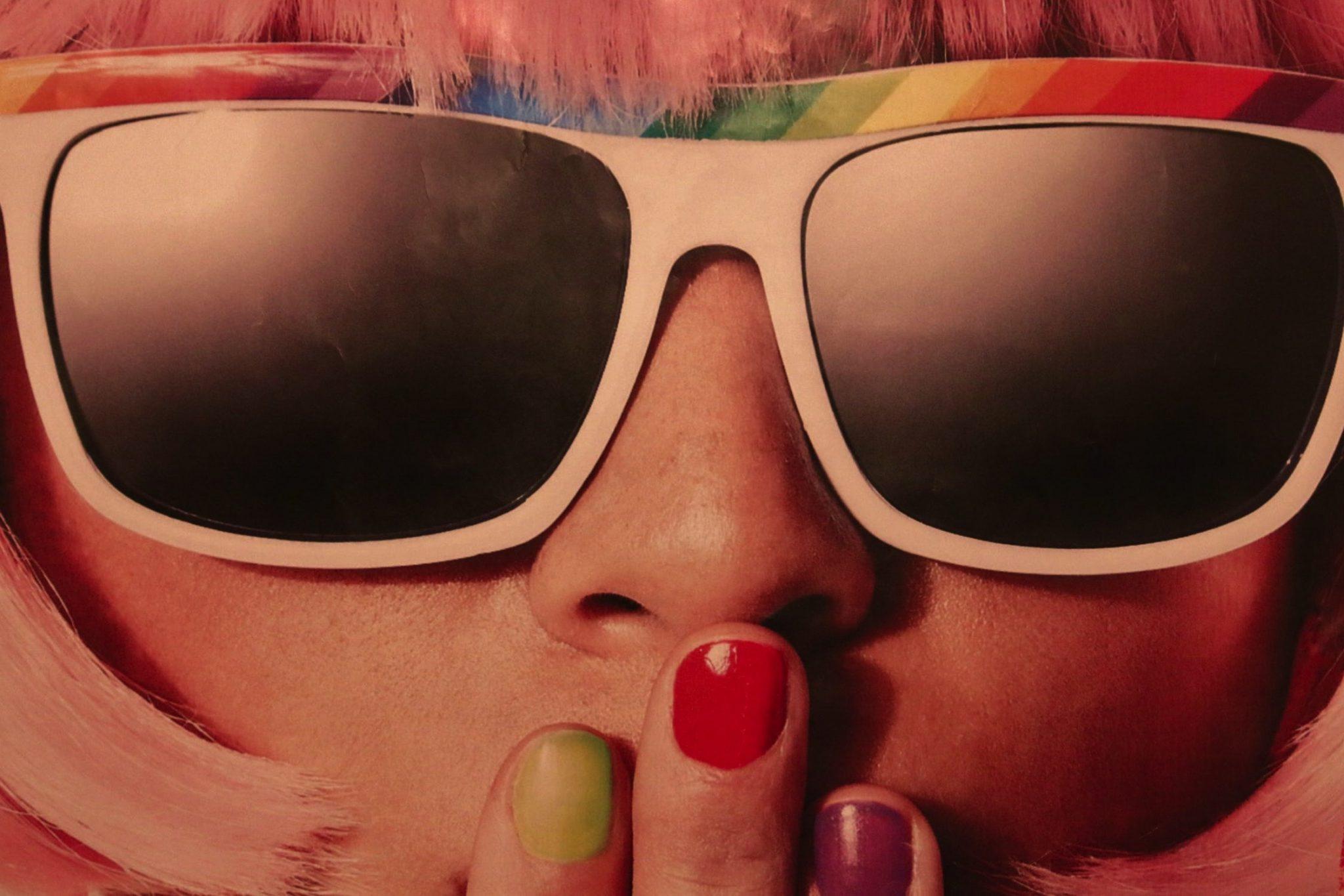 closeup lady wearing sun rainbow glasses