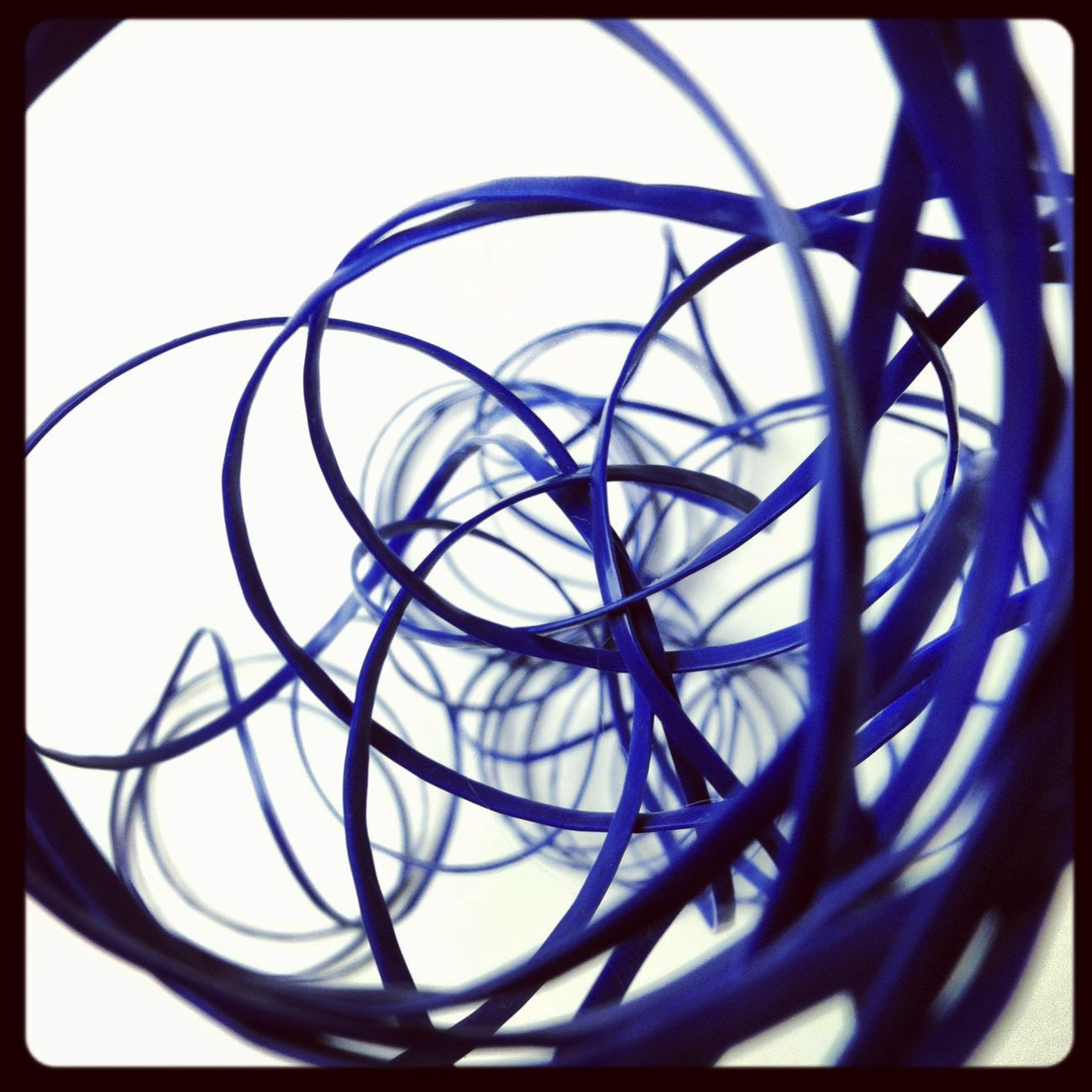 blue swirly wire or plastic
