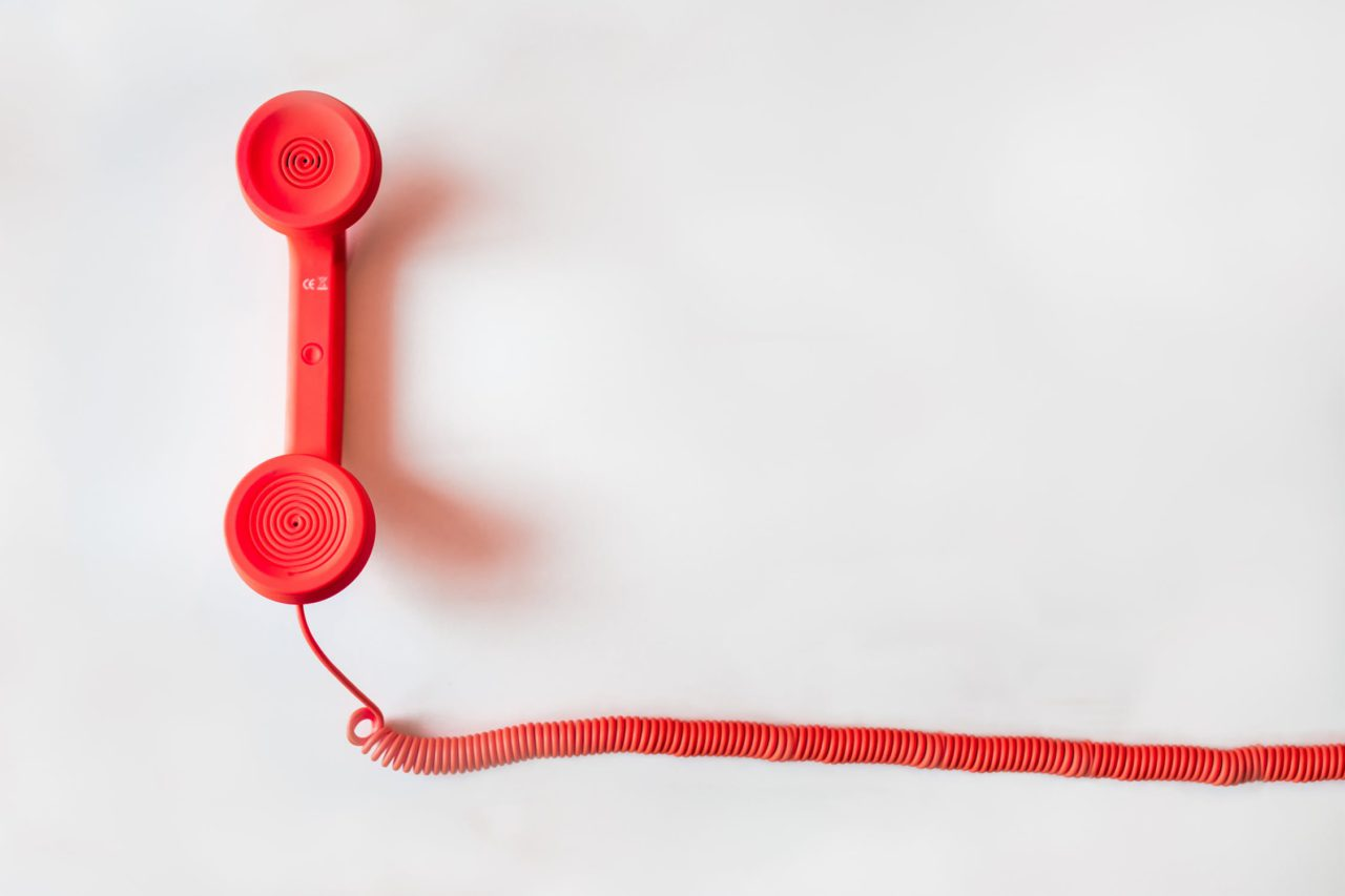 red telephone with a cord