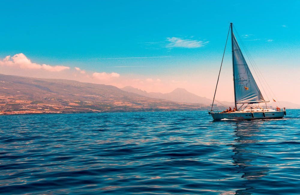 Sailboat on the water with the clouds in the background