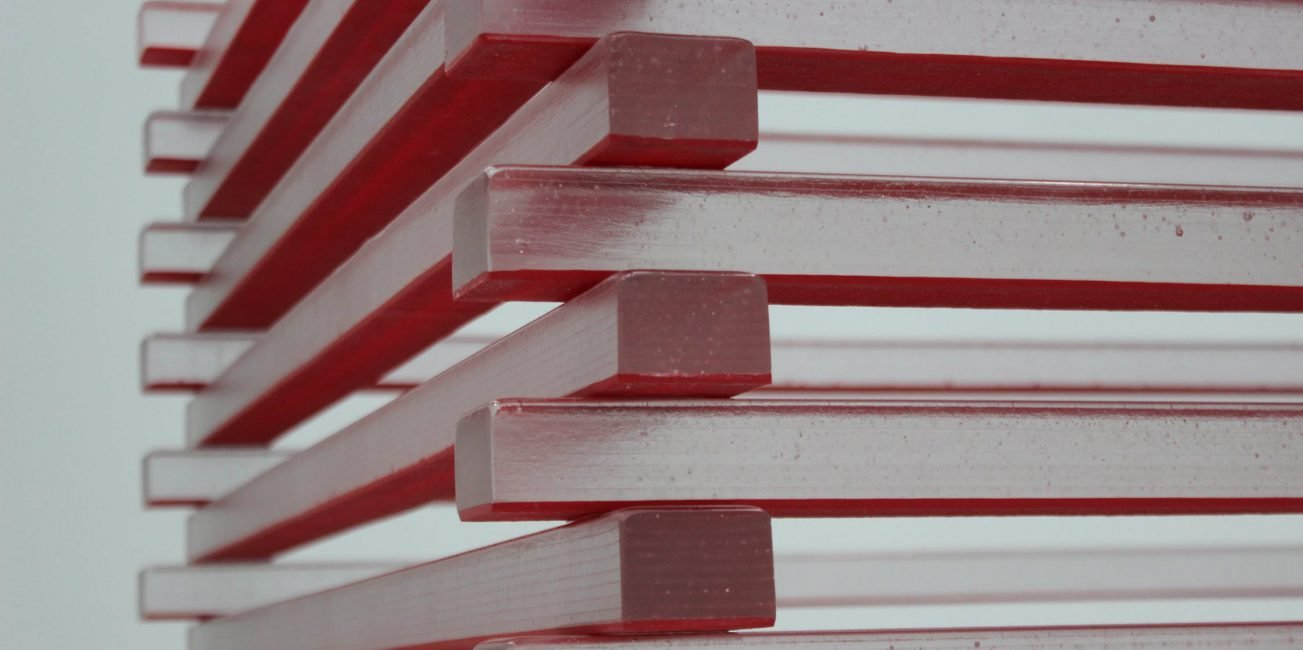 Stacked red and white boards